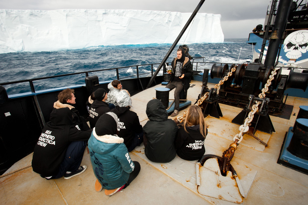 Sea Shepherd crew with books at sea.