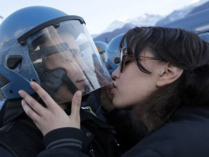 protester-kiss-cop-charged-assault